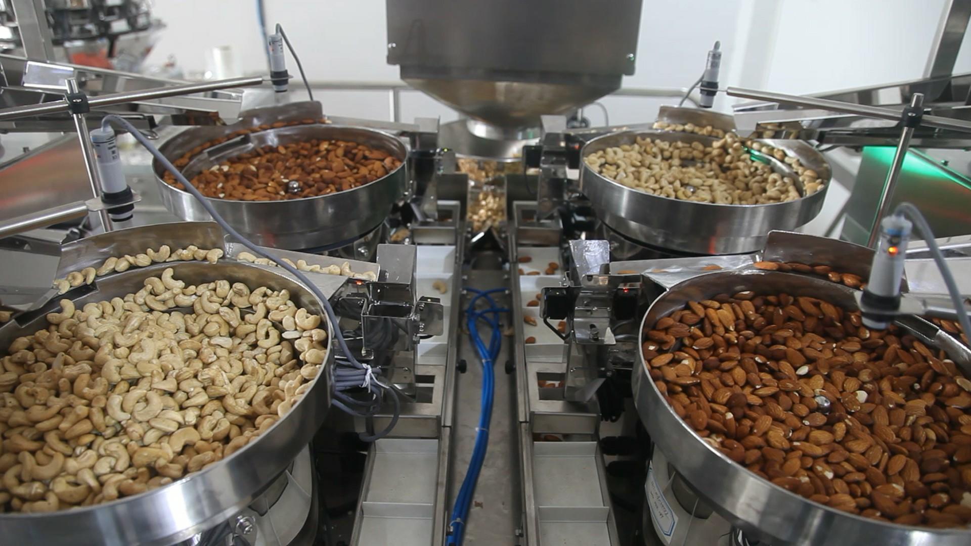 Sistema automático de aplicación de envasado para conteo cuantitativo, pesaje y mezcla de nueces